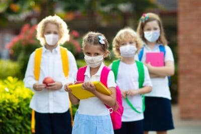 School child wearing face mask. Virus outbreak.
